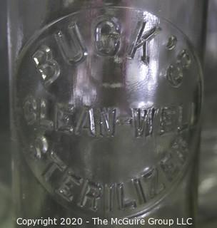 Large Grouping of Vintage Clear Glass Bottles.