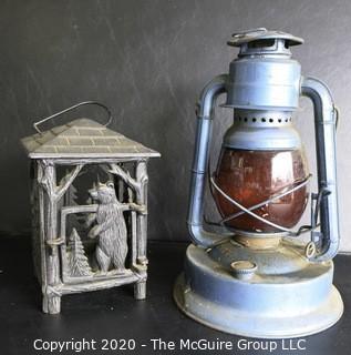 Two Vintage Lanterns.  One Cast Iron and One Blue Dietz Kerosene Lamp.