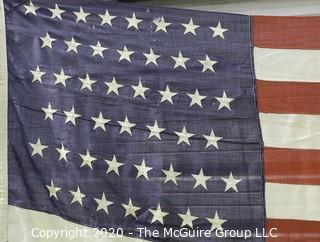"Large 45 Star American Flag with Stitched Stripes and Printed Stars; 1896-1906; Measures approximately 62 x 88""."