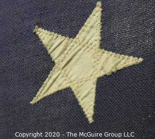 """Antique 48 Star American Flag with Stitched Stripes and Stars.  Damage in the bottom corner that has been repaired. Measures approximately 45 x 67""""."""