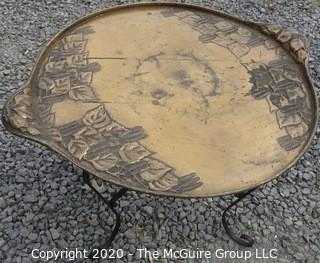 """Persian Copper Tray Coffee Table with Cast Iron Stand.  Measures approximately 26"""" in diameter and 19"""" tall."""