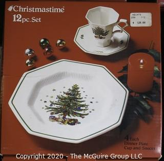 Several New Boxed Place Settings of Christmastime China.