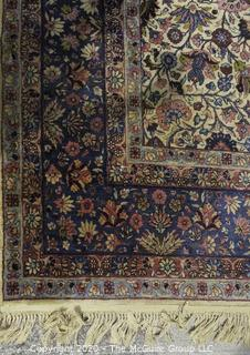 "Kerman Persian Circa 1940 Hand Knotted Wool on Wool Rectangular Field with Flowers and Leaves on Beige Ground Surrounded by Five Border Guards.  Measures approximately 105"" x 145""."