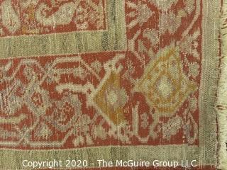 """Sehna Early 20th Century Hand Knotted Wool on Wool with Rectangular Center Field of Abstract Figures on Red Ground Surrounded by Wide Border Guard with Low Nap.  Measures approximately 78"""" x 55"""".  Has much wear."""