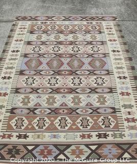 "Hand Knotted Wool Kilim Rug with Geometric Pattern in Brown on Beige Ground.  Measures approximately 105"" x 67""."