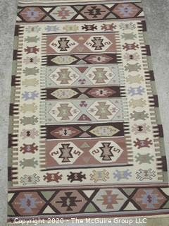 Small Hand Knotted Wool Kilim Rug with Geometric Pattern in Brown on Beige Ground.