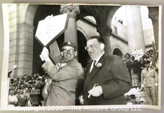 "Vintage 1958 Black and White United Press Telephoto - Los Angeles Mayor Norris Poulson Holds up Home Plate from Brooklyn Dodgers. Measures approximately 9"" x 6"" with some curling at edges."