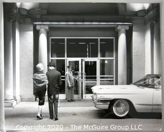 Large Format Black & White Photo of Couple walking into hotel.  Presumed Rickerby