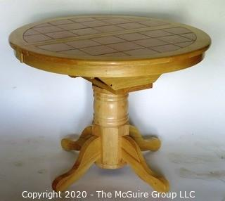 Round Pedestal Table with Terracotta Tile Top and Hidden Expandable Leaf Underneath.