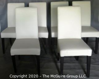 "Set of 6 White Faux Leather Dining Chairs with Black Wooden Legs; 1 chair has 4"" vertical rip near top of back.  (Description altered 7/29/20 @ 18:39 ET)"