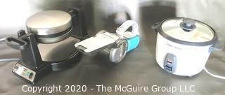 Group of Small Kitchen Appliances Includes Hand Held Vacuum, Waffle Maker and Slow Cooker.