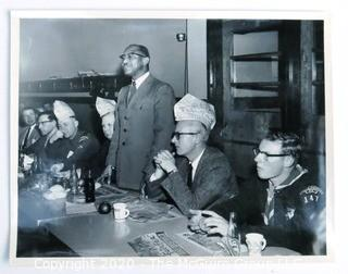 Photo: Historical: Fairfax VA: undated: Boy Scouts of America meeting with members wearing novelty paper hats and a black person speaking
