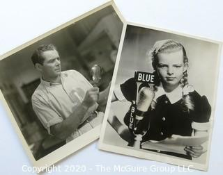 """Vintage Black & White Publicity Stills - Man with magnifying glass and Lorna Lynn (Meyers) as Jill Bartlett on the Blue Network radio show """"My Best Girls"""" Circa 1930."""