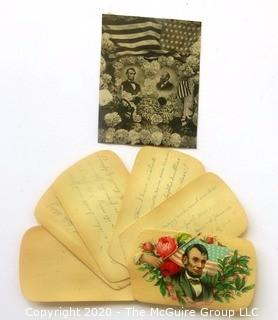 Celluloid Swivel Note Pad with President Lincoln Sticker and Small Lincoln Print.