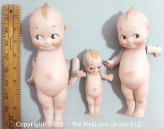 Three Porcelain or Bisque Kewpie Dolls with Frozen Standing Legs.