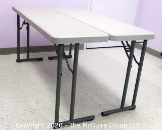 "Set of 2 Industrial Heavy Duty Plastic Folding Tables Made by National Public Seating.   There are four lots of these tables for a total of 8 tables .  Each measure approximately 18"" W, 30"" T  & 60"" long.  Room 20 Kitchen {Marked Lot 68}"