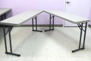 "Set of 2 Industrial Heavy Duty Plastic Folding Tables Made by National Public Seating.   There are four lots of these tables for a total of 8 tables .  Each measure approximately 18"" W, 30"" T  & 60"" long.  Room 20 Kitchen {marked lot 70}"