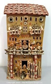 "Large Ayacucho Peruvian Ceramic Folk Art Story Building with People. Measures approximately 22"" x 13"" x 7"""