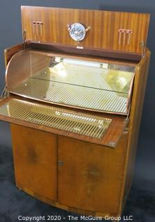 "1930's Art Deco: Rivington Cabinet Works (London) Mid Century Dry Bar with Lighted Fold down door and mirrored panels with accessories.  Measures approximately 42""W 31""T 15""D. Vintage Furniture"