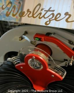 "Wurlitzer Jukebox, 1954 Model F-1700, restored with manual and 45 rpm records.  In addition, (2) Matching Art Deco Vintage Wurlitzer Model 5205 Remote Wall Box Table Top Jukeboxes; 12 x 12 7.5""D32""W x 28""D x 56""T"