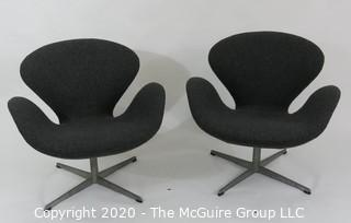 Pair of 1960 Mid Century Modern Arne Jacobson Fritz Hansen Swan Chairs in Charcoal fabric on Chrome Pedestal Base. Label number #0968 with Made in Denmark Stamp on underside. MCM