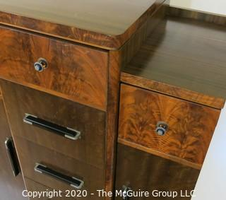 Art Deco Tallboy Dresser Made of Highly Figured Book-Matched Veneer.  5 center drawers flanked by doors (matching pieces to the set are found in Lots 83 and 84)
