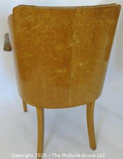 "Two Vintage English Club Chairs with Leather Upholstery and Birds-Eye Maple Veneer, circa 1936.  Small amount of delamination on top ridge of one chair as shown. Outside arm to arm width 25.5""; inside seat to seat width 17"", seat depth 18.5"", seat height 19.5"", height at back 35.5"")"