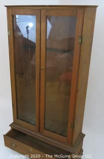 "Wooden Gun Case with Bottom Drawer and Glass Paneled Doors. 31W x 11.5D x 64.5""T"