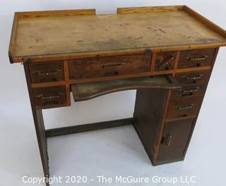 "Industrial Wood Jeweler's Desk or Watchmakers Work Bench with Railings, Drawers in Range of Sizes to Keep Tools Organized and Catch Tray for catching bench sweeps.  Some Damage to Base. 40""W x 20""D x 36""T"