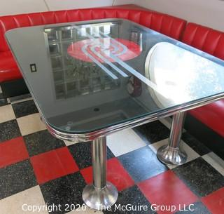 "Furniture: 1950's style ""Diner"" booth with two-piece corner banquette, 2 red stools, 2 black stools and glass topped chrome table on 4 pedestal feet.  Table is 48"" x 68"" x 31""T; Banquette is 73"" end to wall x 90"" end to wall. Banquette is 30.5"" tall at back x 17.5"" seat height.  Stools are 21""T. Note: photo shows 1.5"" worn banquette seat."