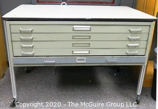 "Industrial Steel Flat File Table with Five Drawers on Legs with Casters.  Measures approximately 57"" x 38"" x 39""."