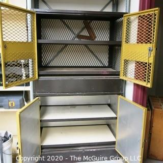 "Metal Wall Cabinet with Mesh Doors.  Measures approximately 62"" tall x 35"" wide x 20"" deep."