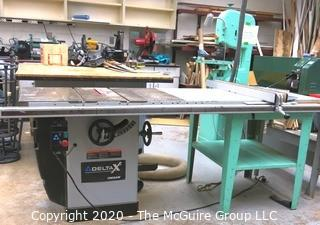Delta X5 UNISAW Table Saw with metal base side feed table; 220V; As Is.