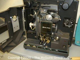Vintage Bell & Howell Model 2592 16mm film projector w film