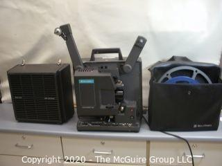 Bell & Howell Model 1268, 16mm film projector, w/carrying cover and reels. As is.
