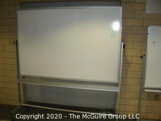 """Double sided white board on casters, 48"""" x 72"""" and 78"""" tall (a few dings)"""