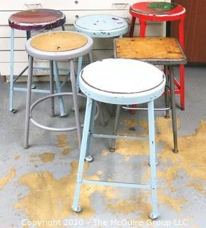 (6) Industrial Stools in Varying Heights and Styles.  Some painted by students.  The red stool with green illustration is missing from this lot.  Lot is now only for 5 stools.   Description altered on 12/28 at 5:06 PM EST.