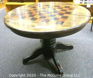 "Wooden Round Pedestal Game Table; 42"" in diameter."