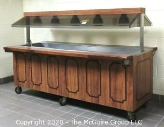 Buffet serving station on casters with overhead lights