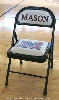 Padded Metal Folding Chair with George Mason Logo.  Used as Home Basketball Team Seating in the Pit