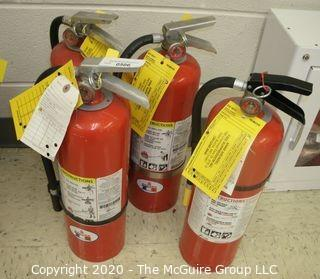 (4) Fire Extinguishers and Hangers; 3 Badger & 1 brand unknown
