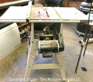 """Ridged Tr2412 10"""" Table Saw On Stand; Condition Unknown."""