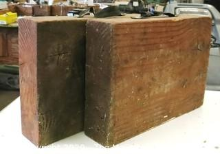 (2) SOLID WOODEN BLOCKS WITH STRAP HANDLES