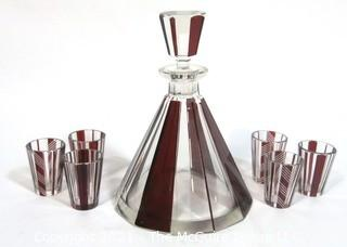 "Palda Bohemian Czech Art Deco Cut Glass Liquor Decanter with Red Decoration and 6 Glasses.  Some chips in glasses. <br> <br> Many of the Karl Palda Bohemian Art Deco cut glass pieces in this auction were featured in the book ""Collectible Bohemian Glass (1915 – 1945) Volume II"" by Robert & Deborah Truitt."