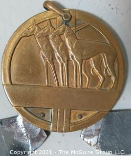 Gentleman's Round Art Deco Bronze or Brass Pocket Knife Fob or Cigar Cutter with Greyhound Motif.