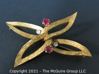 Vintage Ladies Brooch Made of 18k gold with (2) Rubies and (2) Diamonds.  Weighs approximately 10g