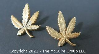 Pair of Vintage 1972 Gold Marijuana Leaf Earrings Made by Adams Apple Chicago.  Originally sold by the National Organization for the Reform of Marijuana Laws (NORML).