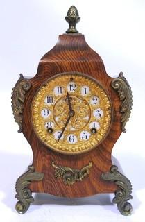 Antique 1904 Ansonia Calais Louis XIV Style 8 Day Mantel Clock in Faux Wood Grained Case.  It measures approximately  7 1/2 inches wide, 14 inches tall & 4 1/2 inches deep.