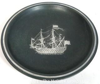 "Gustavsberg Argenta Stoneware Pottery Shallow Bowl Designed by Wilhelm Kage with Silver Ship on Black Base. Measures approximately 12"" in diameter."