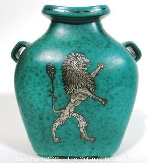 "Gustavsberg Argenta Stoneware Pottery Vase Designed by Wilhelm Kage with Silver Lion on Jade Green Base. Measures approximately 8"" tall.  Damage to bottom of vase."